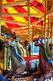 Carousel with horses on a carnival Merry Go Round Royalty Free Stock Photos