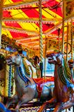 Carousel with horses on a carnival Merry Go Round Stock Photography