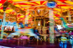 Carousel with horses on a carnival Merry Go Round Royalty Free Stock Images