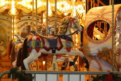 Carousel horses. Colorful carousel horses on poles Stock Images