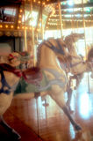 Carousel horses, moody, pastel and hazy. This stock photo shows carousel horses on a merry-go-round.  The scene appears hazy and mystical Royalty Free Stock Image