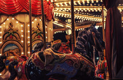 Carousel. With horses under natural lights Royalty Free Stock Images