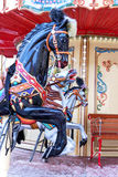 Carousel! Horses on a vintage, retro carnival merry go round. Stock Images