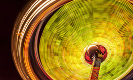 The carousel. This I photographed at the local fair. I used a tripod and long exposure to get the effect of rotation. The image exudes a beautiful and vibrant Stock Images