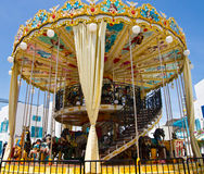 Carousel. Kids toy carousel at an amusement park Royalty Free Stock Photo