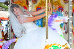 The carousel of life - joyfull bride portrait Stock Photos