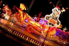 Carousel Lights. Lights of a carousel in motion at night royalty free stock photos