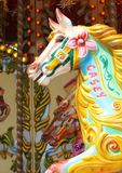 Carousel merry-go-round ride. Victorian merry go round carousel ride at an amusement park funfair with the name Casey on neck Stock Images