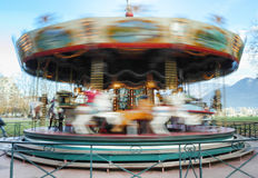Carousel merry-go-round while rounding Royalty Free Stock Image