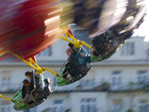 Carousel in motion. Fast moving roundabout in the city Royalty Free Stock Images