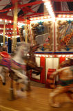 Carousel in motion Stock Photography