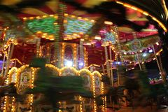 Carousel Moving at Night Stock Images