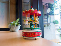 Carousel music box. Near by the window Stock Photography