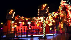 Carousel at night defocused view stock video