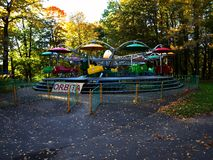 Carousel in an oak park in autumn royalty free stock images