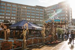 Berlin, October 4, 2017: Carousel and other entertainment and street food for people in the Alexanderplatz square. Local royalty free stock photo