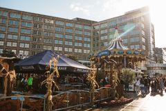 Berlin, October 4, 2017: Carousel and other entertainment and street food for people in the Alexanderplatz square. Local royalty free stock image