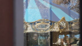 Carousel reflection stock video footage