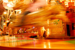 Carousel ride. Blured motion image of a fairground carousel ride Royalty Free Stock Photography