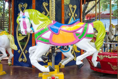 Carousel ride with horses Stock Images