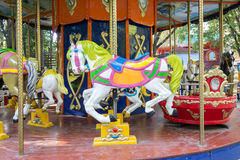 Carousel ride with horses Royalty Free Stock Photography