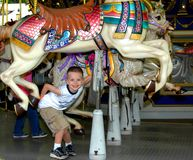 Carousel Ride for a Little Boy stock photo