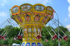 Carousel. The rotating carousel on blue sky background Royalty Free Stock Image