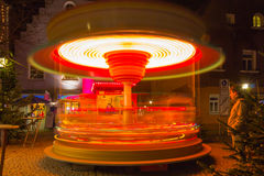 Carousel spins -Christmas bavarian town in evening Stock Photos