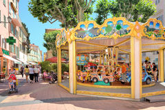 Carousel on the street of Menton, France. Royalty Free Stock Photo