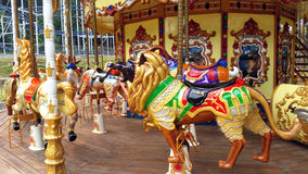 Carousel Theme Park. Carousel horse on a fun fair ride in theme park for fun and happy play Stock Photos