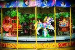 Carousel in themepark. Colorful carusel with horses in theme-park Stock Images