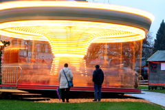 Carousel Velden, Austria. Spinning carousel in winter, advent festivities, high speed Royalty Free Stock Image