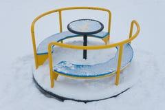 Carousel w playgroundunder śnieg fotografia stock