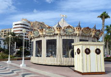 Carousel on the waterfront in the port of Alicante. Stock Photos