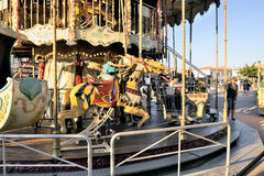 Carousel with wooden horses Royalty Free Stock Photo