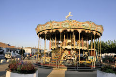 Carousel with wooden horses Stock Images