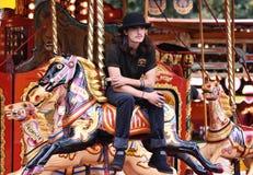Carousel worker riding the carousel. UK. September 2018 stock images