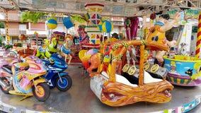 Carousel z koniami i Fred Flintstone Zdjęcia Royalty Free