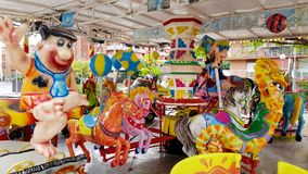 Carousel z koniami i Fred Flintstone Obrazy Royalty Free
