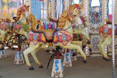 Carousel zabawy jarmarku przejażdżka Fotografia Stock