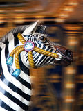 Carousel Zebra. Zebra carousel horse at carnival with blurred background stock photo