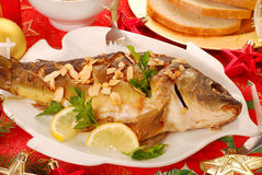 Carp baked with almonds for christmas Stock Photos