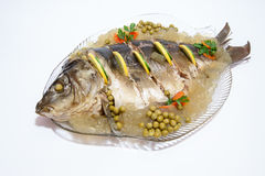 Carp cooked on a plate adorned Stock Image