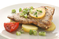 Carp fillet with potato, tomato and lemon Stock Photo