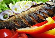 Carp. Fish vegetables food Royalty Free Stock Image