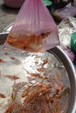 Carp fishes in local market. In Asia mythology, orange carp fishes is not only considered a food but also a mean of transport for kitchen guardians to travel to royalty free stock photos