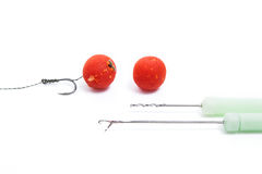 Carp fishing. Carp hook red boilies isolated on white background Stock Images