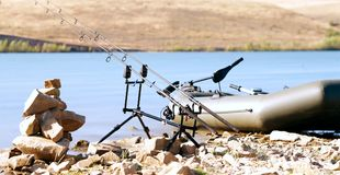 Fishing rods on the lake Royalty Free Stock Photo