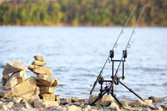 Fishing rods on the lake Stock Photo