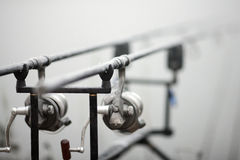 Carp fishing rods. On the racks at the lake Stock Photos